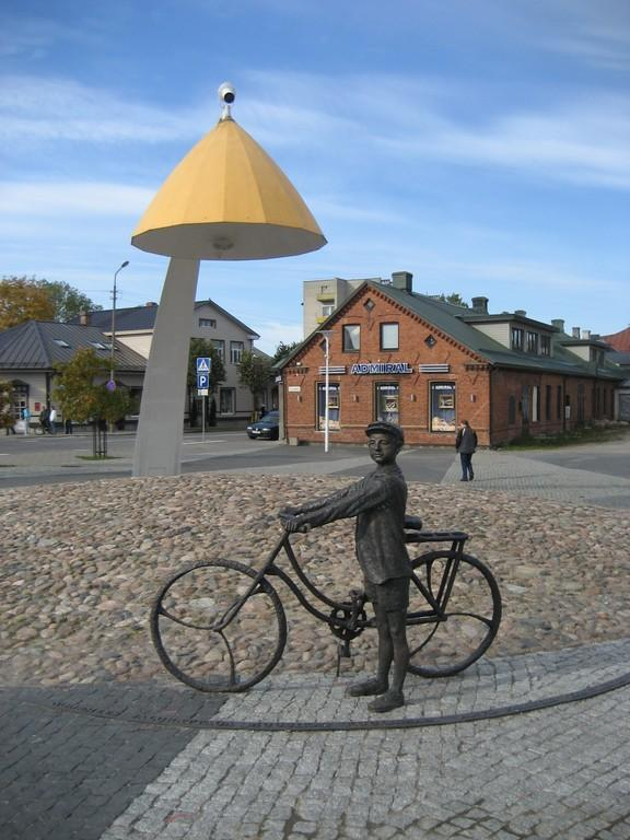 'Young man on bicycle listening to music' sculpture