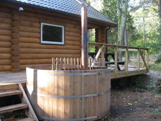 Seaside log sauna with accommodation and hot tub