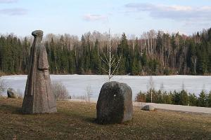 Statue of the Seto lauluimä (song mother) by the lake in early spring