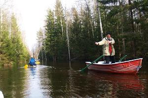 Canoeing on a flooded road in Soomaa