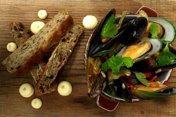 Blue mussles in white wine and butter sauce with hand-made seed ciabatta