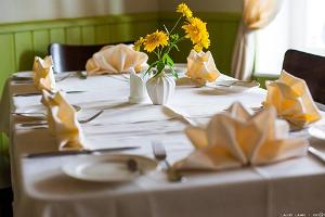 Fresh flowers await diners on every table