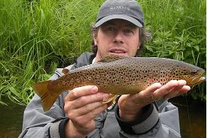 A happy customer with a beautiful river trout