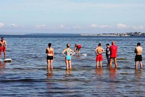 Stand up paddle surfing training in Pirita