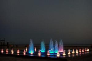 Colourful fountains on Pärnu beach at night