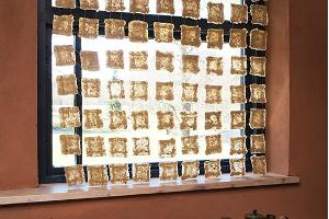 A window blind made from mushroom paper