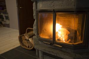 The house has two fireplaces that are used for heating