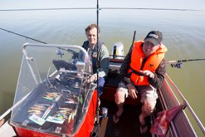 Fishing guide of the Fishing Village on the speedboat Buster L (50 hp engine)
