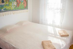Bedroom at the Mesi Tare Home Accommodation