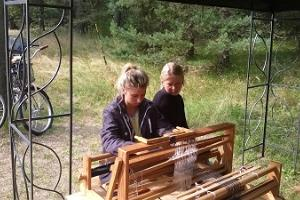 Young people at the loom