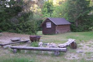 A three-person cottage and a campfire site