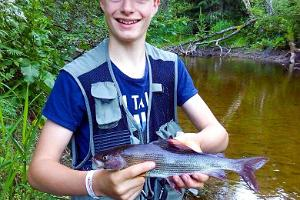 A boy with a grayling