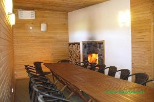 Room with a fireplace and sauna