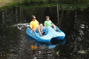 Paddle boating on the pond.